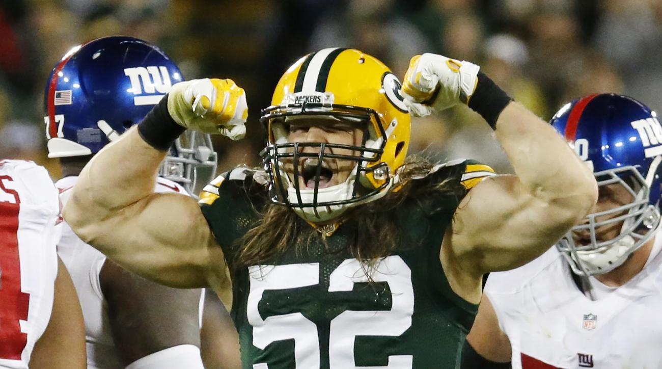 Green Bay Packers' Clay Matthews celebrates a sack of New York Giants quarterback Eli Manning during the second half of an NFL football game Sunday, Oct. 9, 2016, in Green Bay, Wis. (AP Photo/Mike Roemer)