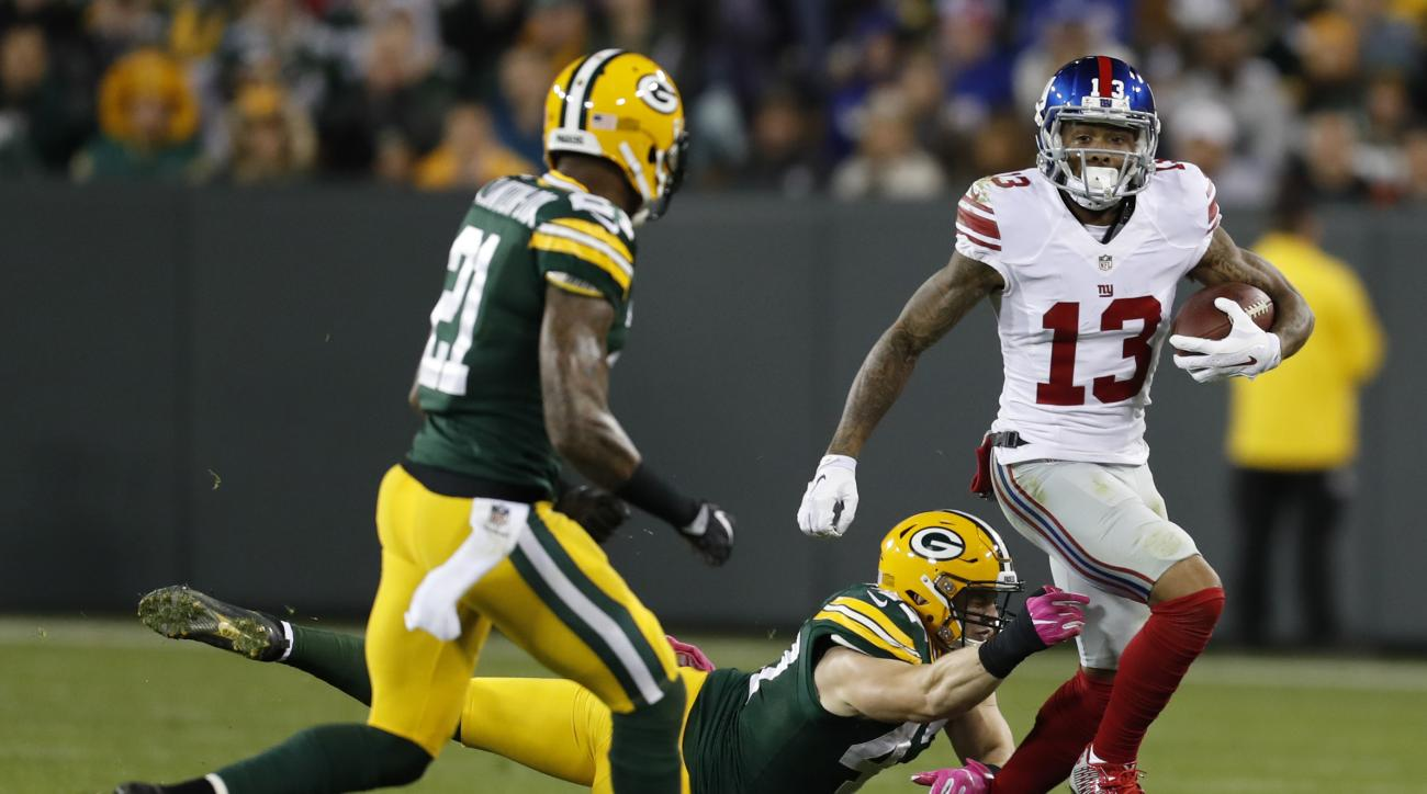 New York Giants' Odell Beckham runs after catching a pass during the second half of an NFL football game against the Green Bay Packers Sunday, Oct. 9, 2016, in Green Bay, Wis. (AP Photo/Matt Ludtke)