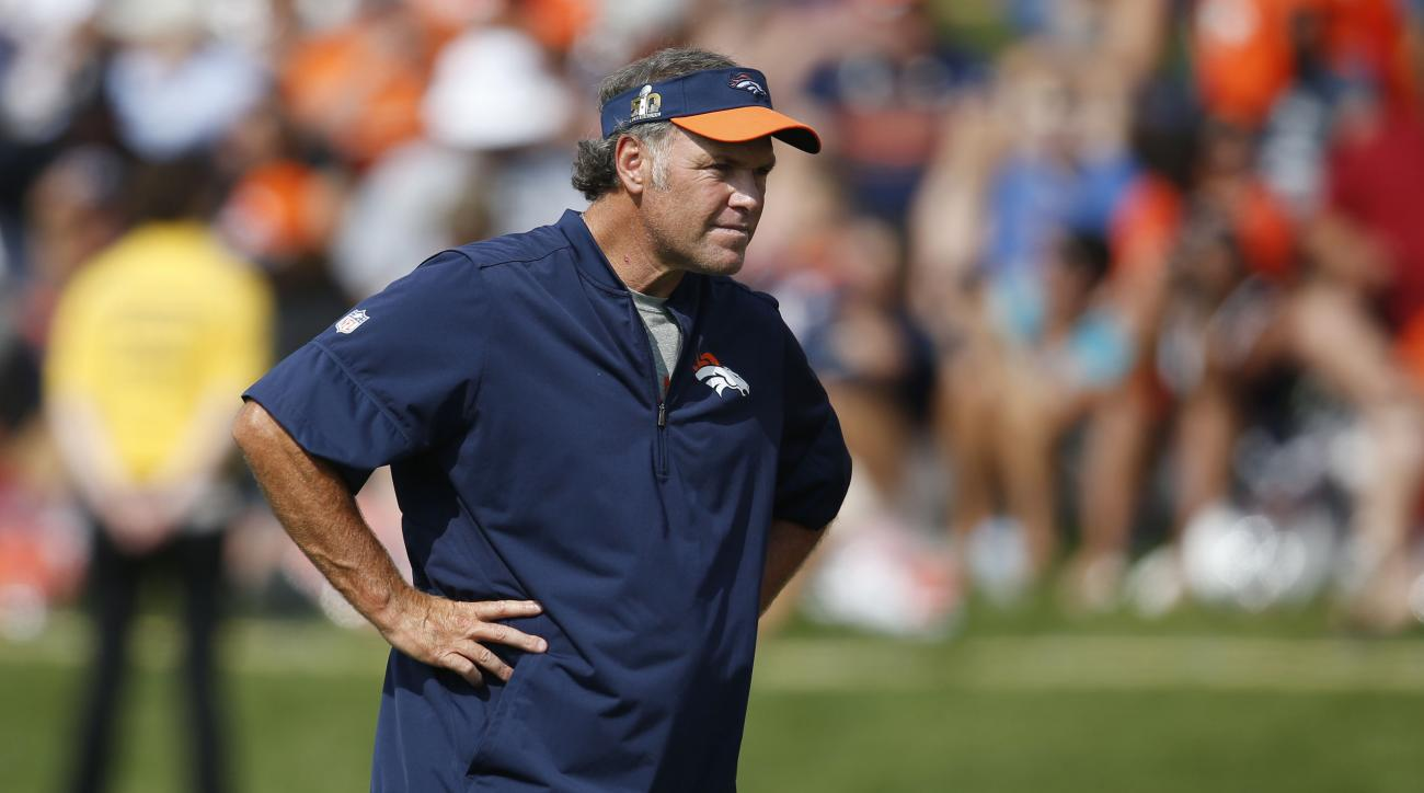 In this Friday, July 29, 2016, photograph, Denver Broncos special teams coach Joe DeCamillis takes part in drills during the team's NFL football training camp in Englewood, Colo. DeCamillis will guide the Broncos when they play against the Chargers in San