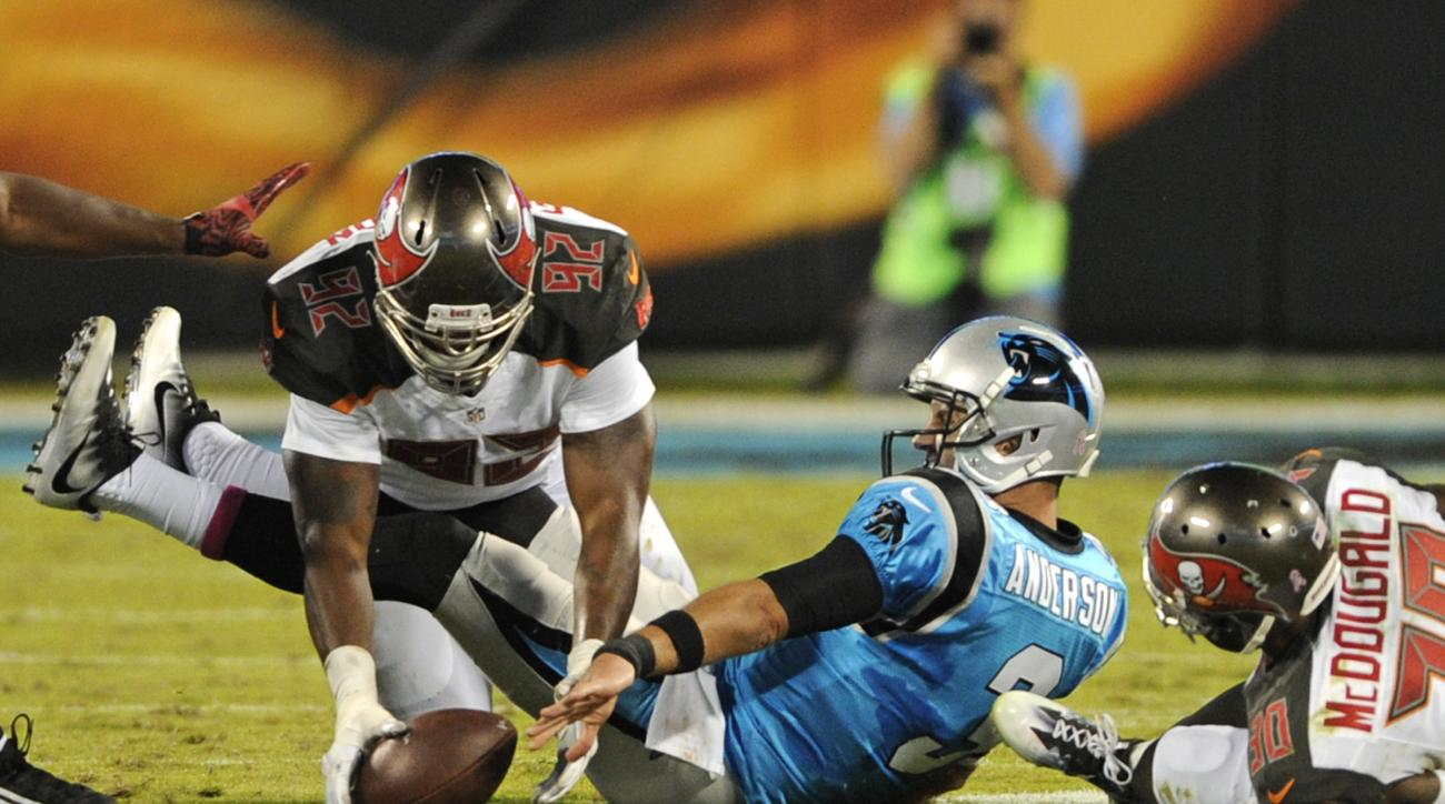 Tampa Bay Buccaneers' William Gholston (92) recovers a fumble by Carolina Panthers' Derek Anderson (3) in the second half of an NFL football game in Charlotte, N.C., Monday, Oct. 10, 2016. (AP Photo/Mike McCarn)