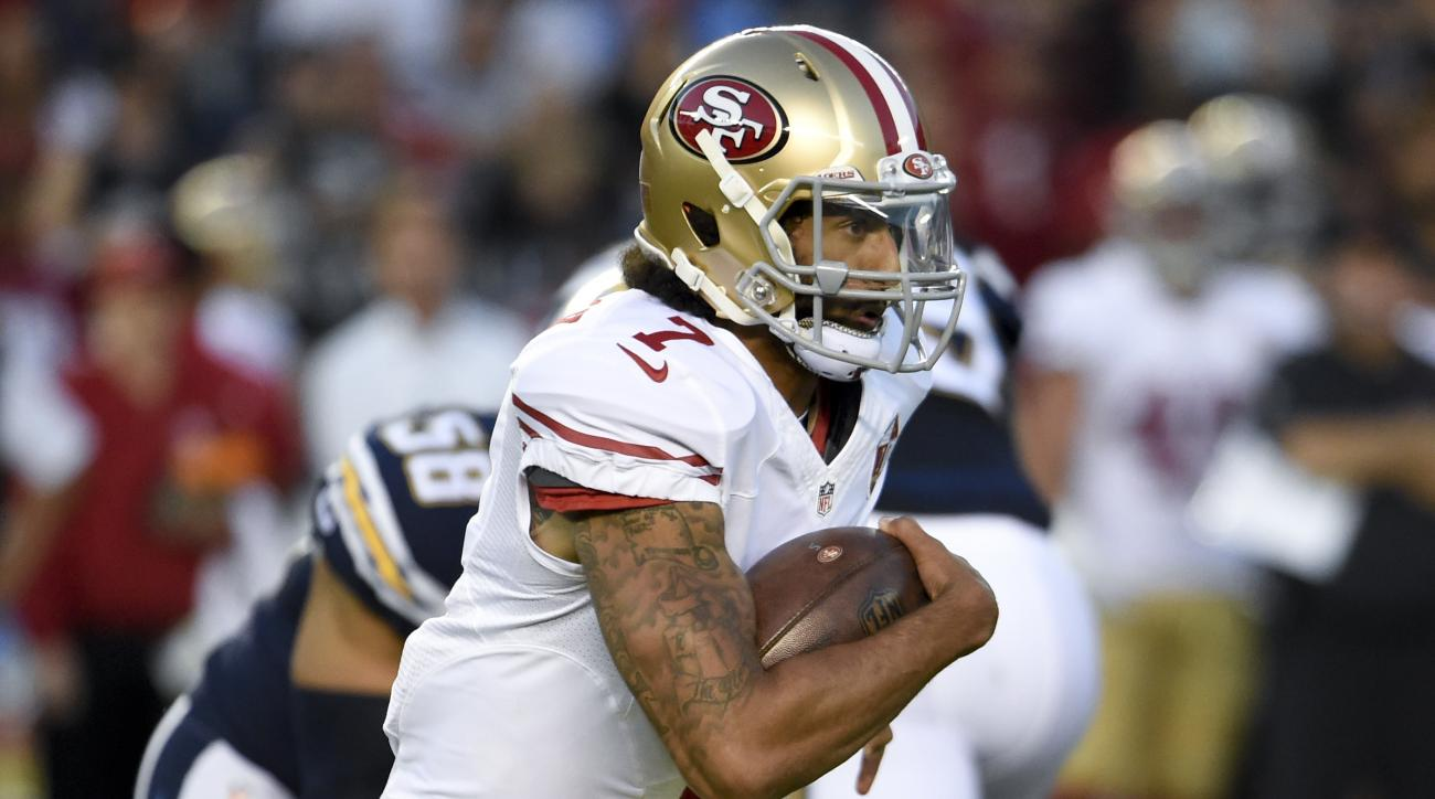 FILE - In this Sept. 1, 2016 file photo, file photo, San Francisco 49ers quarterback Colin Kaepernick runs against the San Diego Chargers during the first half of an NFL preseason football game in San Diego. Making the switch at quarterback from Blaine Ga