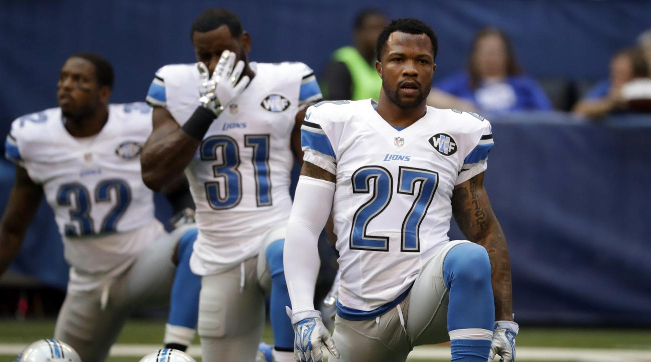 FILE - In this Sept. 11, 2016, file photo, Detroit Lions free safety Glover Quin (27) stretches before an NFL football game against the Indianapolis Colts in Indianapolis. The Lions have made a lot of moves over the years that simply haven't panned out. S