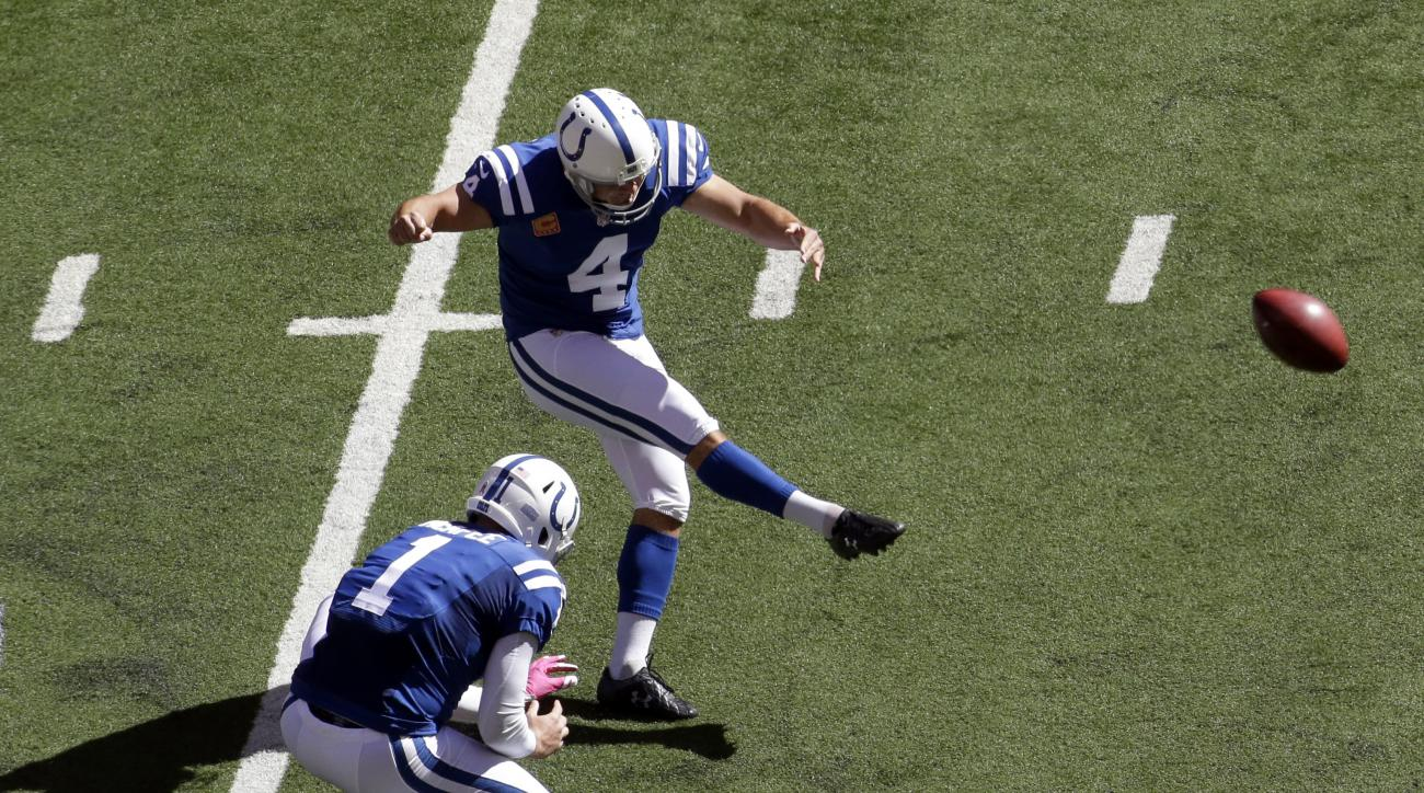 FILE - In this Oct. 9, 2016, file photo, Indianapolis Colts kicker Adam Vinatieri (4) kicks a field goal from the hold of Pat McAfee during the first half of an NFL football game against the Chicago Bears in Indianapolis. Around the Colts' locker room, th