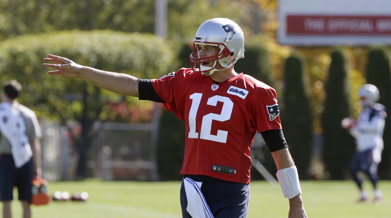 New England Patriots quarterback Tom Brady talks during an NFL football practice Wednesday, Oct. 12, 2016, in Foxborough, Mass. (AP Photo/Steven Senne)