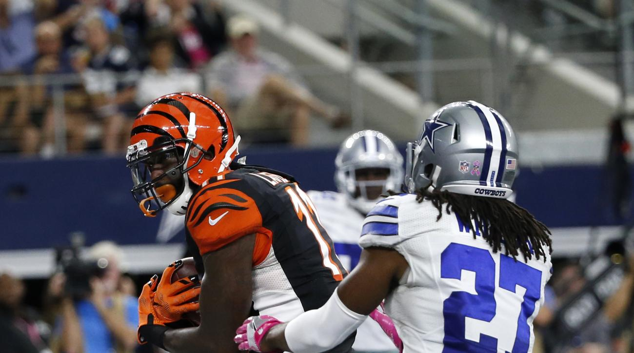 FILE - In this Sunday, Oct. 9, 2016, file photo, Cincinnati Bengals wide receiver Brandon LaFell (11) catches a pass in the end zone for a touchdown in front of Dallas Cowboys free safety J.J. Wilcox (27) in the second half of an NFL football game in Arli