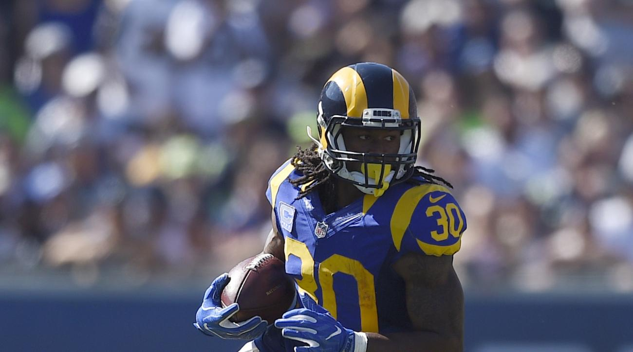 FILE - In this Sept. 18, 2016, file photo, Los Angeles Rams running back Todd Gurley (30) runs against the Seattle Seahawks during an NFL game in Los Angeles. The Rams and Lions play Sunday, Oct. 16, 2016.  (AP Photo/Kelvin Kuo, File)