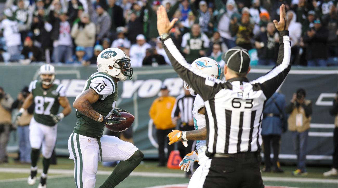 FILE - In this Nov. 29, 2015, file photo, New York Jets wide receiver Devin Smith (19) celebrates after catching a pass for a touchdown during the first half of an NFL football game against the Miami Dolphins, in East Rutherford, N.J. Brandon Marshall rea