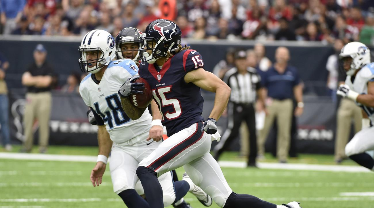 FILE - In this Oct. 2, 2016, file photo, Houston Texans wide receiver Will Fuller (15) returns a punt 67-yards for a touchdown against the Tennessee Titans during the second half of an NFL football game in Houston. The  Titans have given up punt returns f