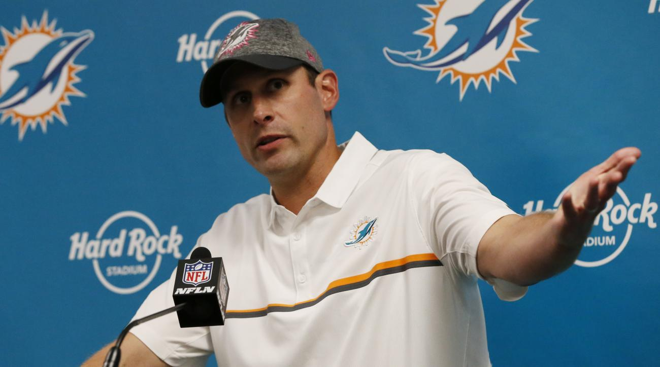 FILE - In this Oct. 9, 2016, file photo, Miami Dolphins head coach Adam Gase speaks during a post-game news conference after an NFL football game against the Tennesse Titans in Miami Gardens, Fla. Following last weeks dismal home loss against Tennessee, d