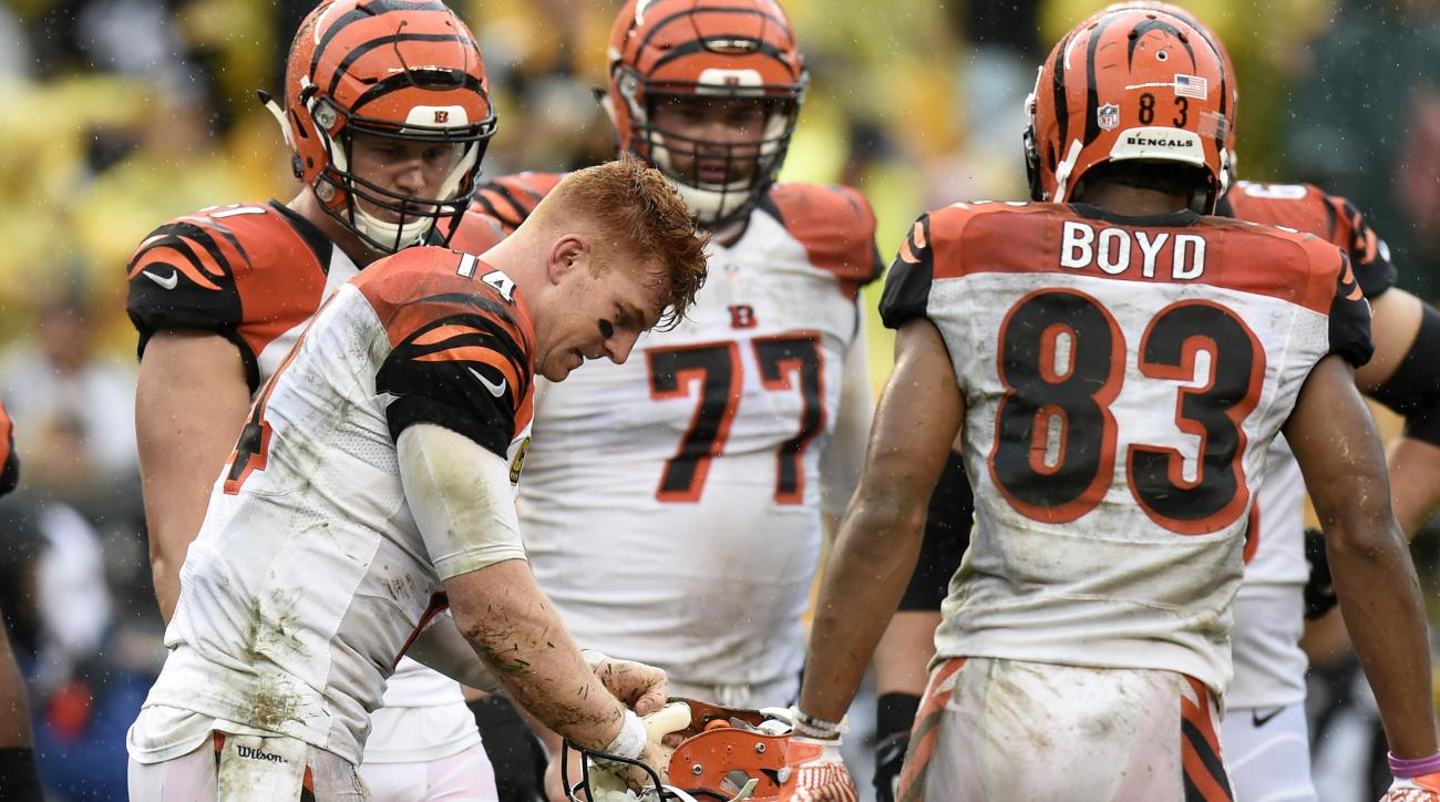 FILE - In this Sept. 18, 2016, file photo, Cincinnati Bengals quarterback Andy Dalton (14) adjusts his helmet during the second half of an NFL football game against the Pittsburgh Steelers, in Pittsburgh. The Bengals were one of the best teams at protecti