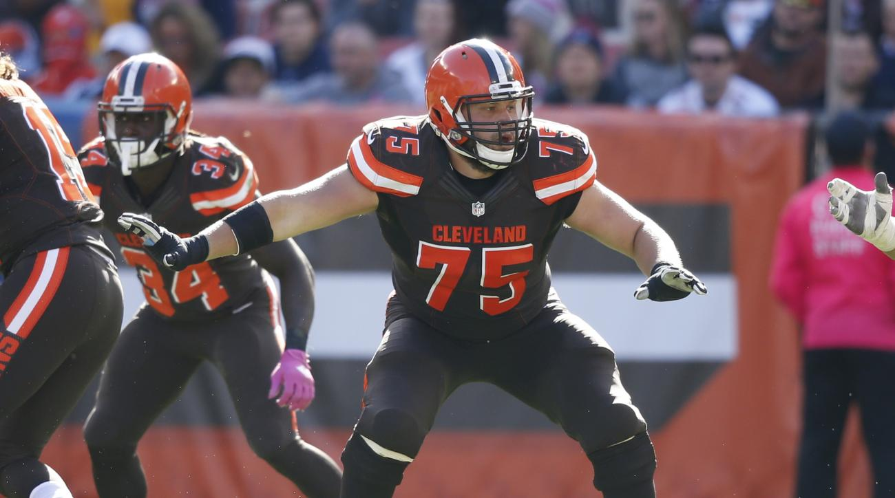 FILE - In this Oct. 9, 2016, file photo, Cleveland Browns' Joel Bitonio looks to block against the New England Patriots during the second half of an NFL football game, in Cleveland. Decimated by injuries since the season opener, Cleveland placed starting
