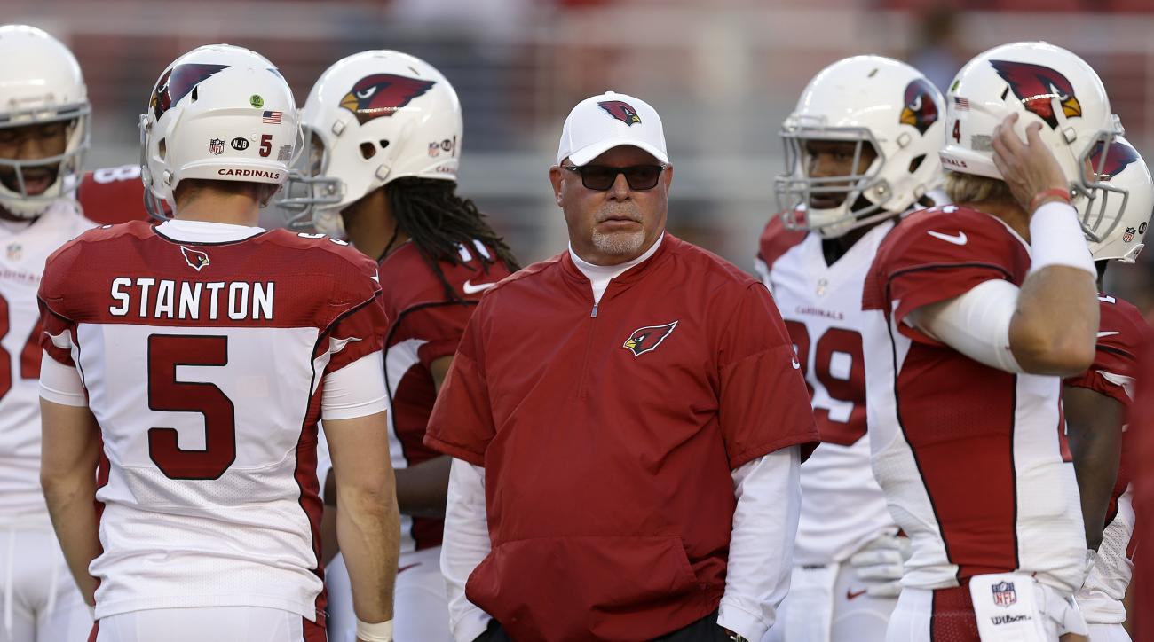 FILE- In this Oct. 6, 2016 file photo, Arizona Cardinals head coach Bruce Arians, center, before an NFL football game against the San Francisco 49ers in Santa Clara, Calif. The Cardinals host the New York Jets on Monday night. (AP Photo/Ben Margot, File0