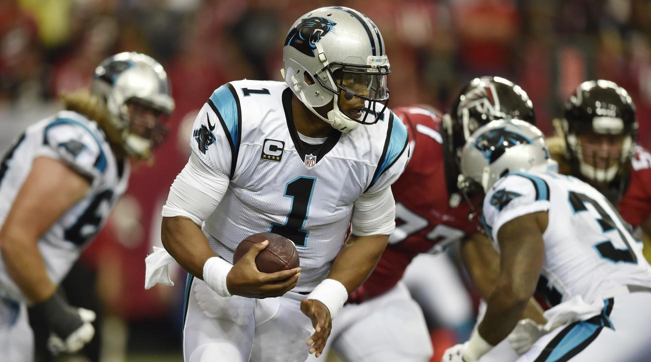 FILE - In this Oct. 2, 2016, file photo, Carolina Panthers quarterback Cam Newton (1) runs out of the pocket against the Atlanta Falcons during the first half of an NFL football game in Atlanta. Newton  has been cleared from the NFLs concussion program an