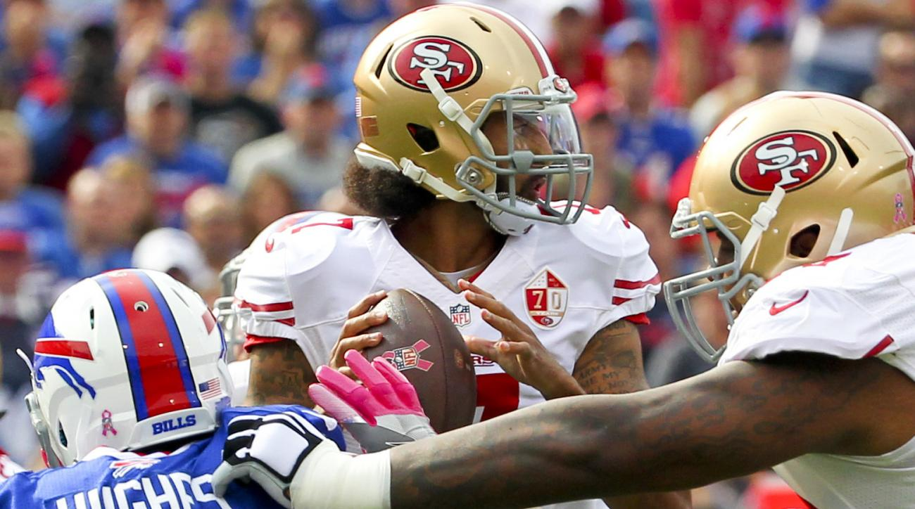 San Francisco 49ers quarterback Colin Kaepernick (7) passes under pressure from Buffalo Bills outside linebacker Jerry Hughes (55) during the first half of an NFL football game on Sunday, Oct. 16, 2016, in Orchard Park, N.Y. (AP Photo/Bill Wippert)