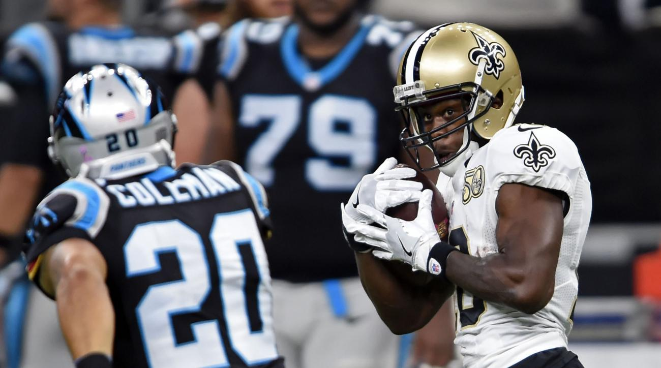 New Orleans Saints wide receiver Brandin Cooks (10) pulls in a touchdown reception in front of Carolina Panthers strong safety Kurt Coleman (20) in the first half of an NFL football game in New Orleans, Sunday, Oct. 16, 2016. (AP Photo/Bill Feig)