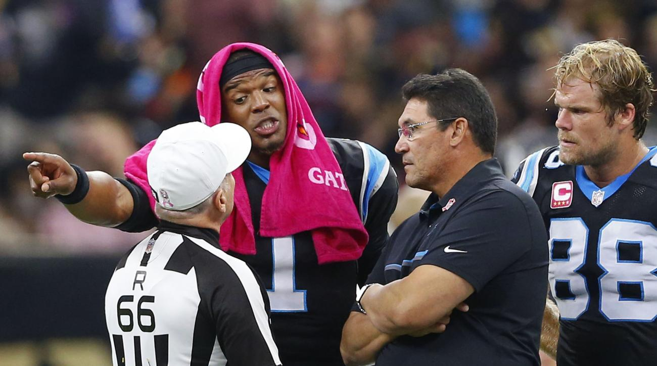 Carolina Panthers quarterback Cam Newton (1), head coach Ron Rivera and tight end Greg Olsen (88) talk to an official in the first half of an NFL football game against the New Orleans Saints in New Orleans, Sunday, Oct. 16, 2016. (AP Photo/Butch Dill)