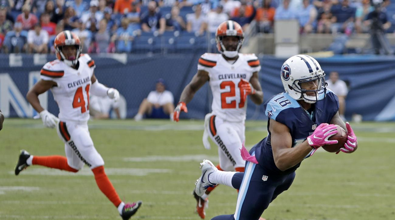 Tennessee Titans wide receiver Rishard Matthews (18) catches a pass for a 43-yard gain against the Cleveland Browns in the second half of an NFL football game Sunday, Oct. 16, 2016, in Nashville, Tenn. (AP Photo/James Kenney)
