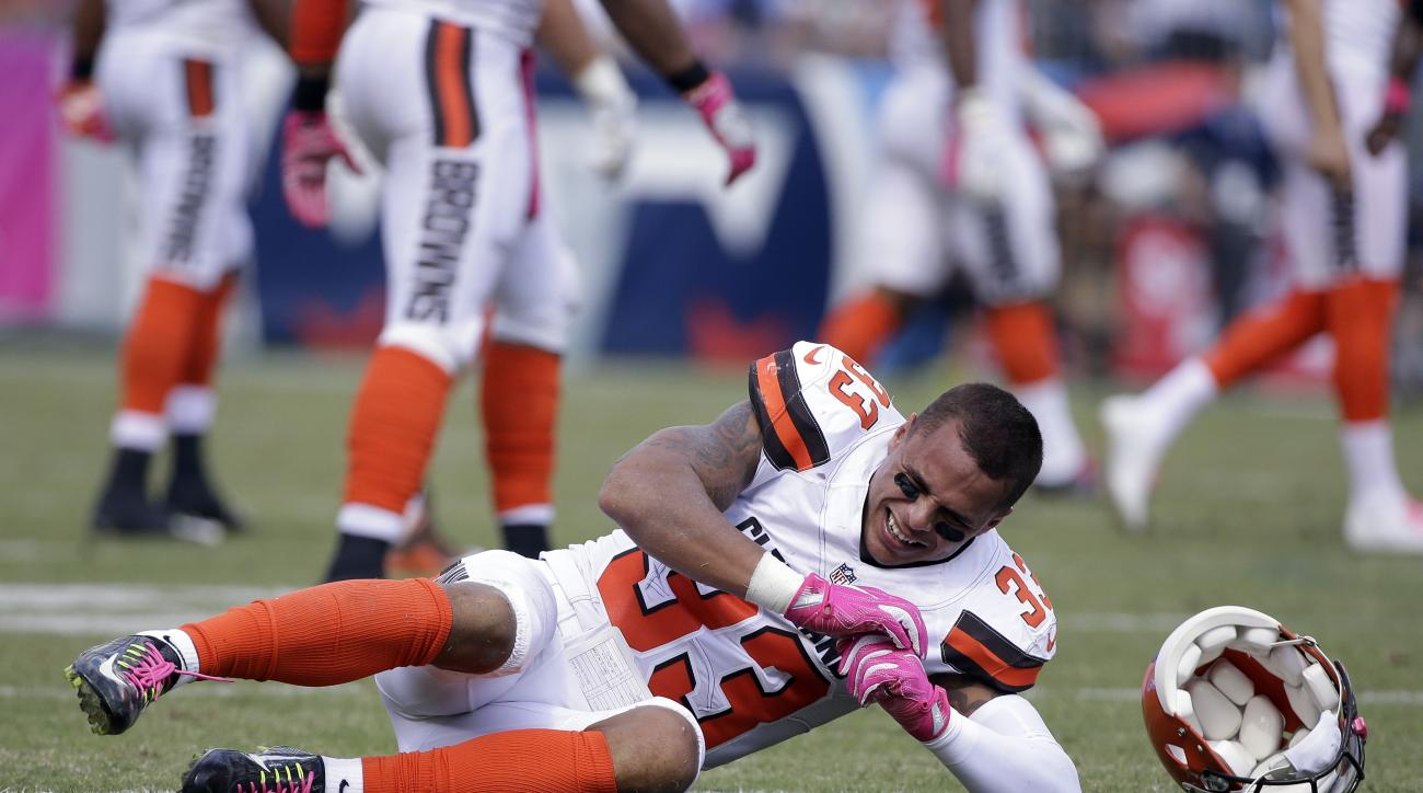 Cleveland Browns free safety Jordan Poyer falls to the ground after being injured in the first half of an NFL football game against the Tennessee Titans Sunday, Oct. 16, 2016, in Nashville, Tenn. (AP Photo/James Kenney)