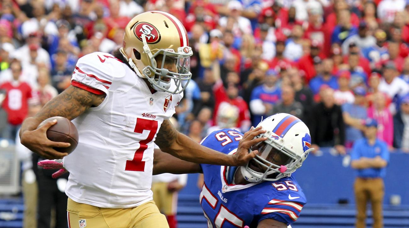 San Francisco 49ers quarterback Colin Kaepernick (7) pushes off Buffalo Bills outside linebacker Jerry Hughes (55) during the second half of an NFL football game on Sunday, Oct. 16, 2016, in Orchard Park, N.Y. (AP Photo/Jeffrey T. Barnes)