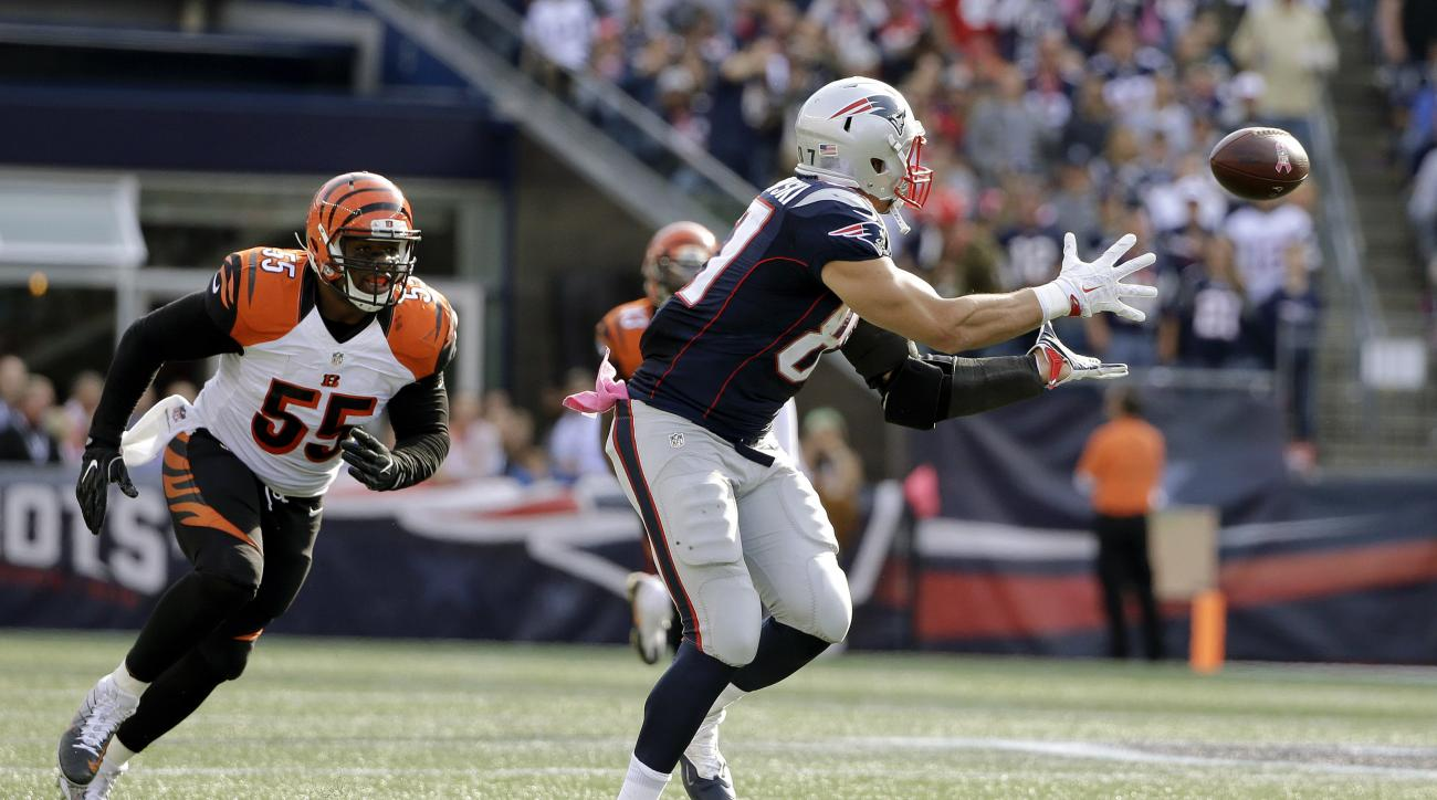 New England Patriots tight end Rob Gronkowski (87) catches a pass in front of Cincinnati Bengals linebacker Vontaze Burfict (55) during the second half of an NFL football game, Sunday, Oct. 16, 2016, in Foxborough, Mass. (AP Photo/Elise Amendola)