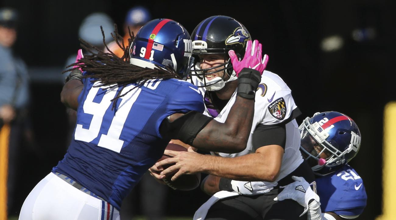 Baltimore Ravens quarterback Joe Flacco (5) is sacked by New York Giants' Landon Collins (21) as Kelvin Sheppard (91) closes in during the first half of an NFL football game, Sunday, Oct. 16, 2016, in East Rutherford, N.J. (AP Photo/Seth Wenig)
