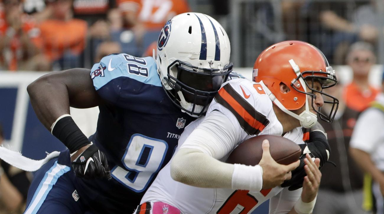 Cleveland Browns quarterback Cody Kessler (6) is sacked by Tennessee Titans outside linebacker Brian Orakpo (98) in the second half of an NFL football game Sunday, Oct. 16, 2016, in Nashville, Tenn. (AP Photo/James Kenney)