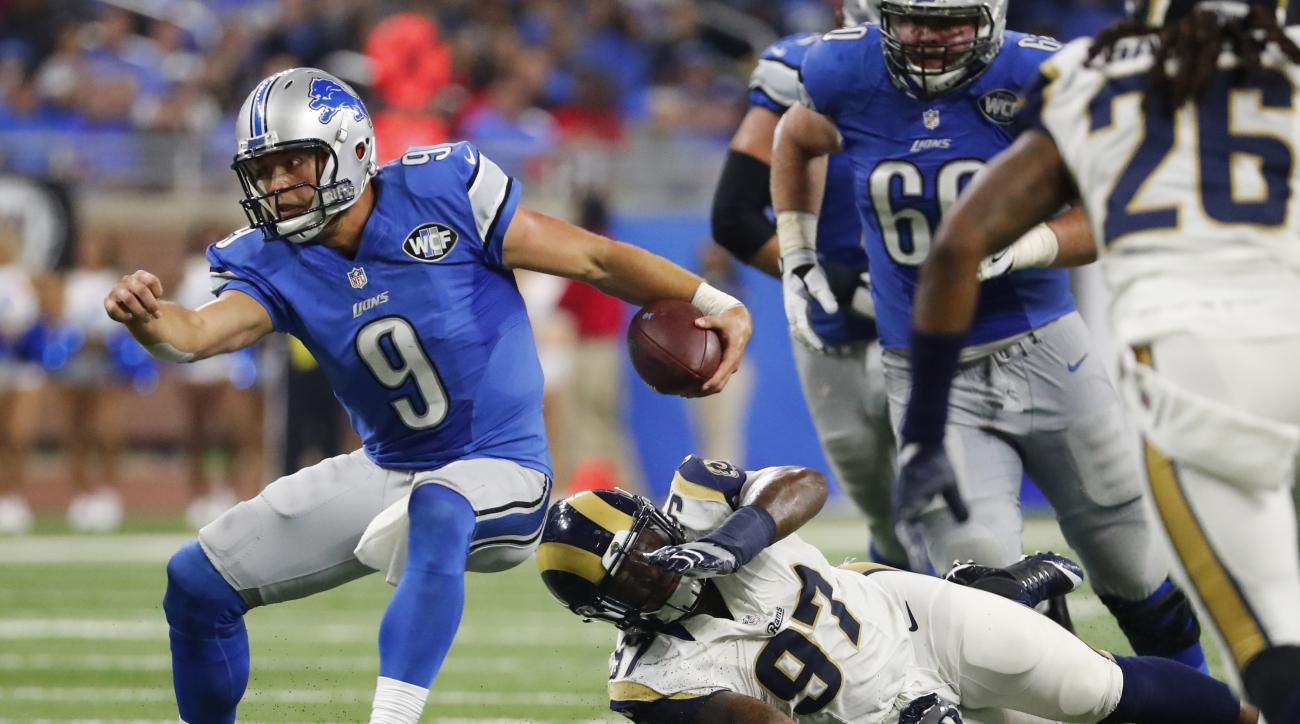 Detroit Lions quarterback Matthew Stafford (9) outruns Los Angeles Rams defensive end Eugene Sims during the second half of an NFL football game, Sunday, Oct. 16, 2016, in Detroit. (AP Photo/Rick Osentoski)