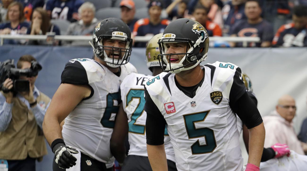 Jacksonville Jaguars quarterback Blake Bortles (5) celebrates a touchdown against the Chicago Bears during the second half of an NFL football game in Chicago, Sunday, Oct. 16, 2016. (AP Photo/Jeff Roberson)
