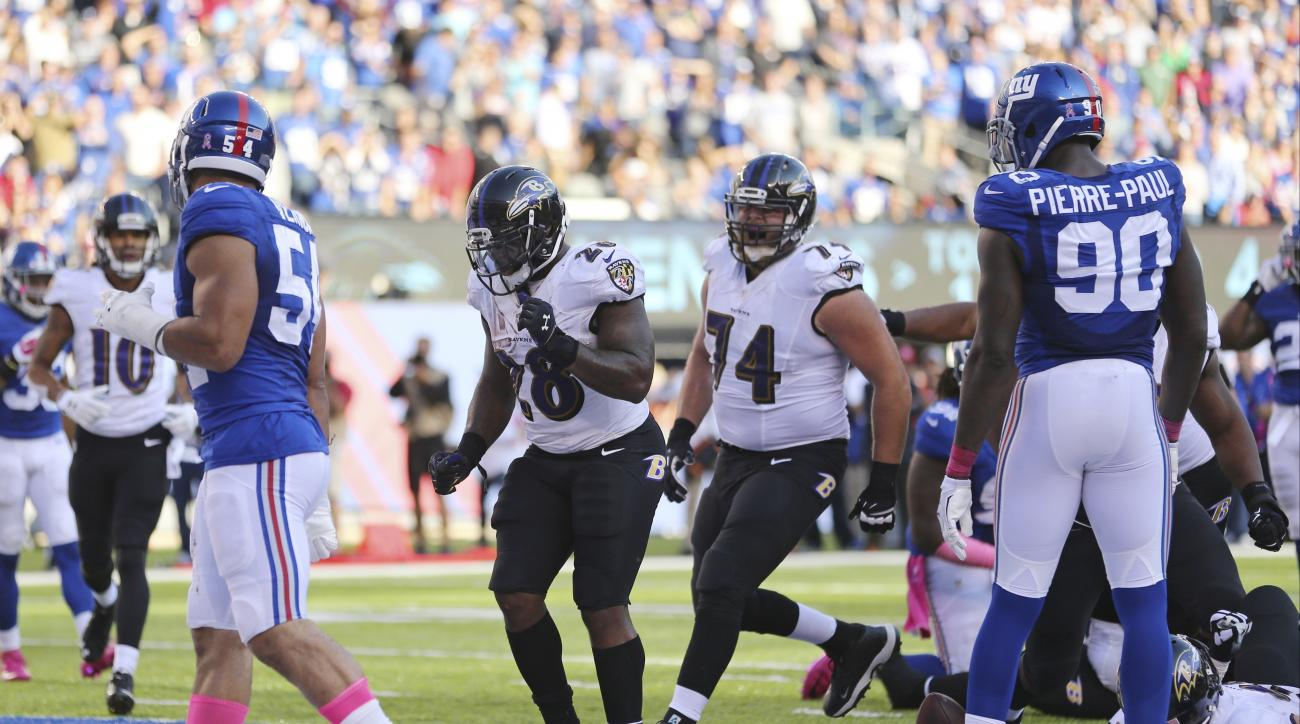Baltimore Ravens running back Terrance West (28) celebrates with James Hurst (74) after scoring a touchdown during the second half of an NFL football game against the New York Giants, Sunday, Oct. 16, 2016, in East Rutherford, N.J. (AP Photo/Seth Wenig)