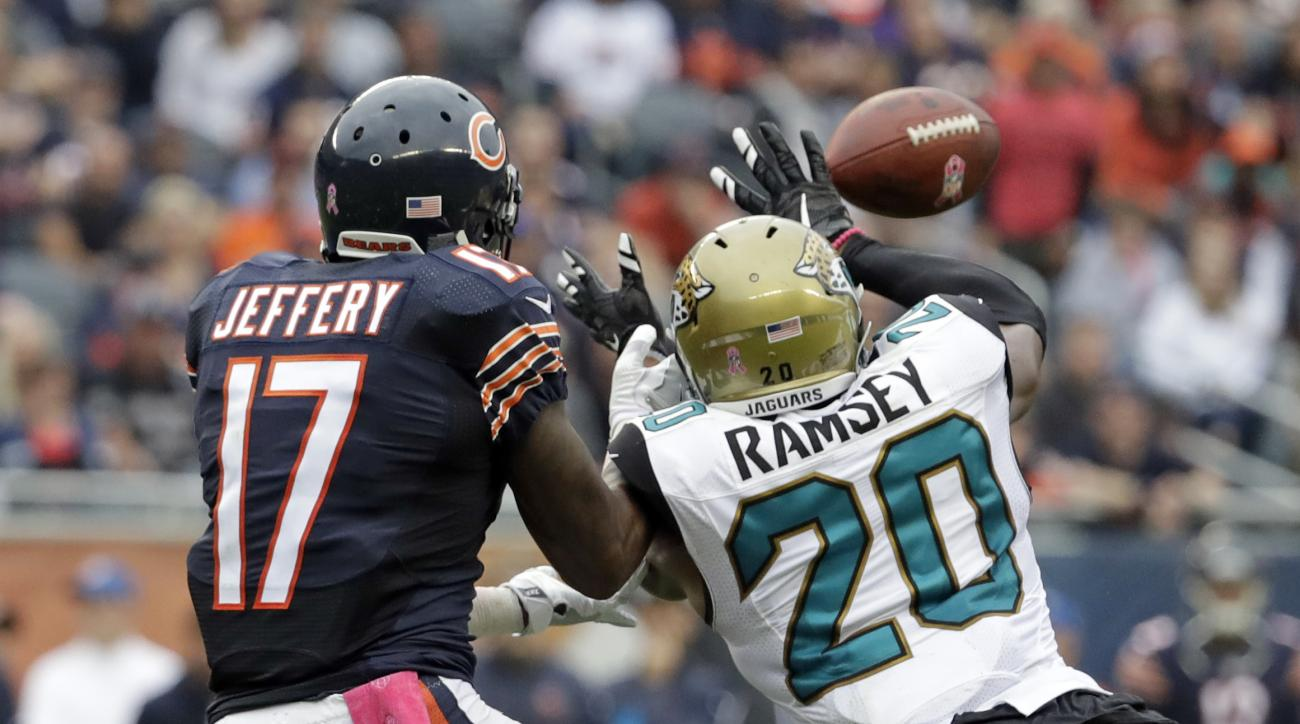 Jacksonville Jaguars cornerback Jalen Ramsey (20) breaks up a pass intended for Chicago Bears wide receiver Alshon Jeffery (17) on the Bears final play of the second half of an NFL football game in Chicago, Sunday, Oct. 16, 2016. (AP Photo/Jeff Roberson)