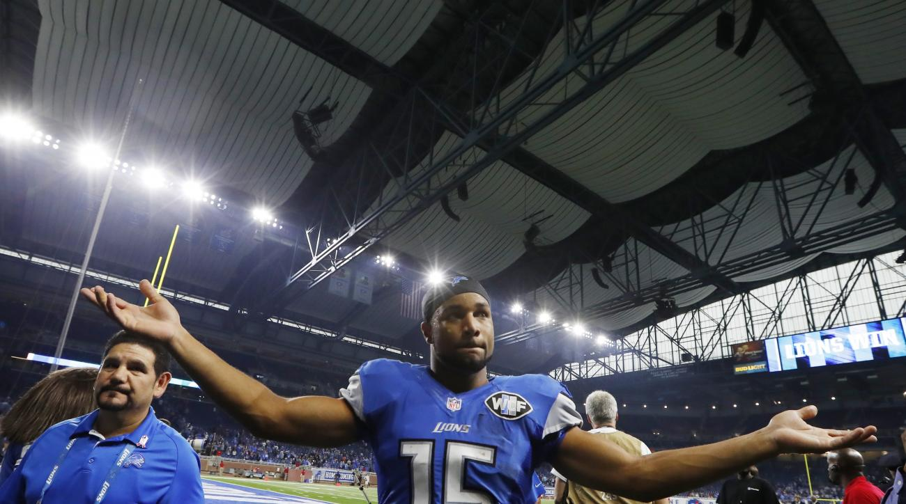 Detroit Lions wide receiver Golden Tate acknowledges the fans after an NFL football game against the Los Angeles Rams, Sunday, Oct. 16, 2016, in Detroit. Tate had eight receptions for a career-high 165 yards and a touchdown. (AP Photo/Paul Sancya)