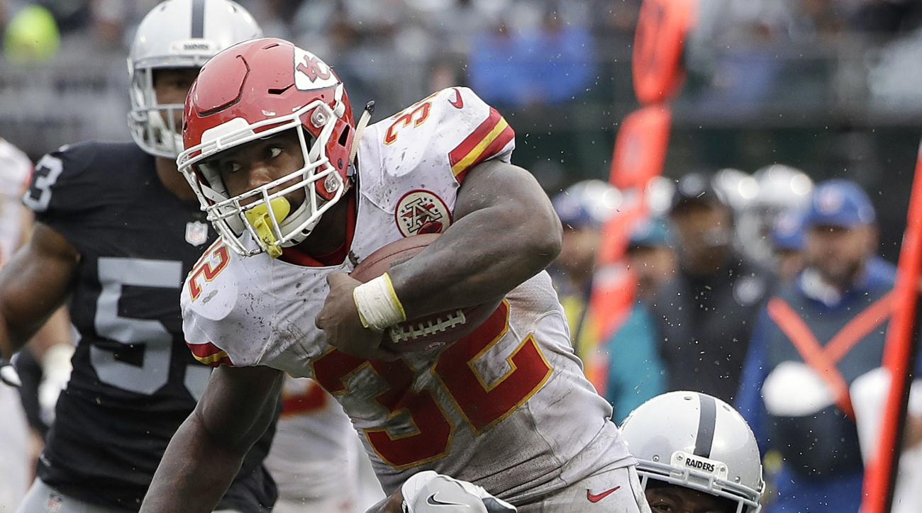 Kansas City Chiefs running back Spencer Ware (32) runs against Oakland Raiders cornerback Sean Smith (21) during the second half of an NFL football game in Oakland, Calif., Sunday, Oct. 16, 2016. (AP Photo/Marcio Jose Sanchez)