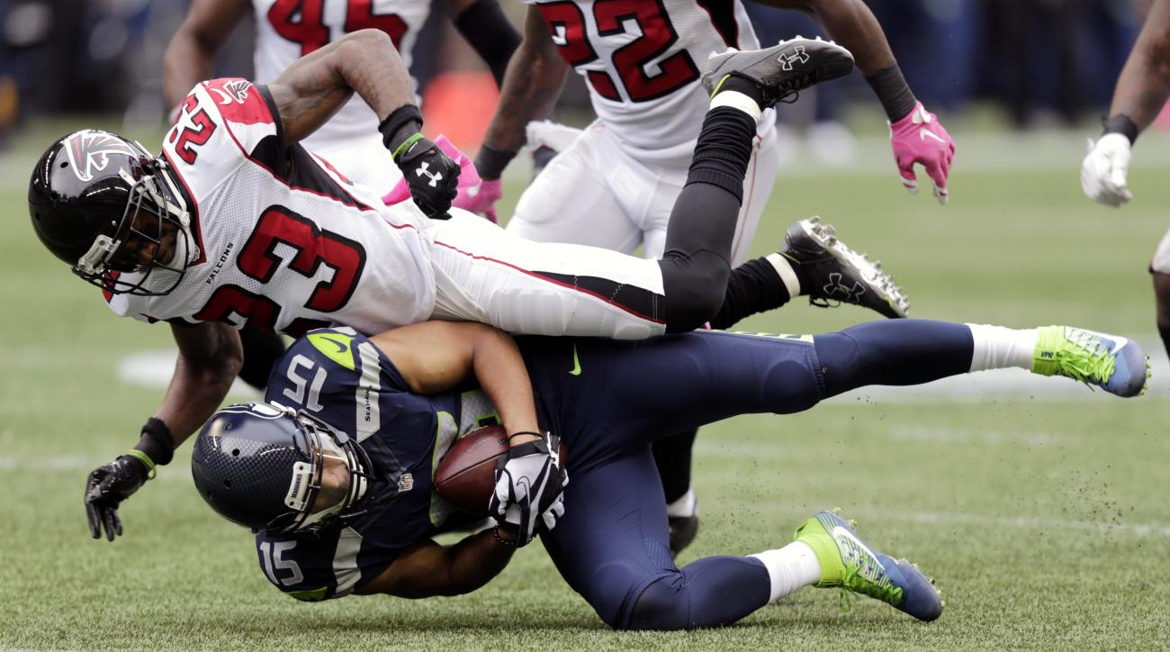 Atlanta Falcons cornerback Robert Alford (23) comes down atop Seattle Seahawks wide receiver Jermaine Kearse after a reception in the second half of an NFL football game, Sunday, Oct. 16, 2016, in Seattle. (AP Photo/Stephen Brashear)