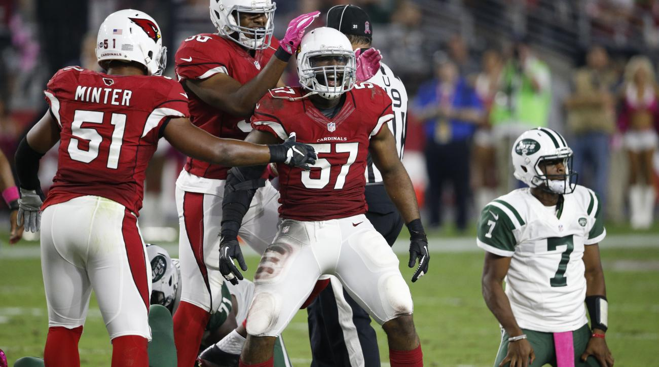 Arizona Cardinals outside linebacker Alex Okafor (57) celebrate his sack of New York Jets quarterback Geno Smith (7) during the second half of an NFL football game, Monday, Oct. 17, 2016, in Glendale, Ariz. The Cardinals won 28-3. (AP Photo/Ross D. Frankl