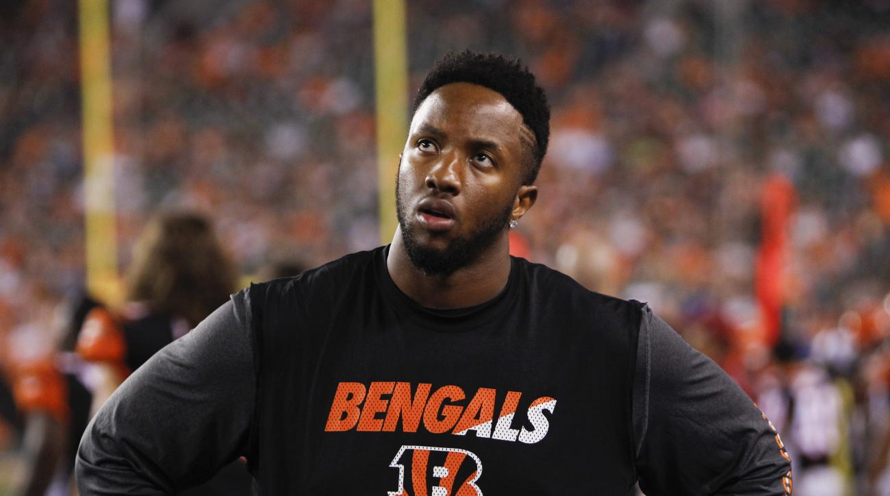 FILE - In this Aug. 29, 2015, file photo, Cincinnati Bengals offensive tackle Cedric Ogbuehi stands on the sidelines in the first half of an NFL preseason football game against the Chicago Bears, in Cincinnati. Ogbuehi got benched once in college for a su