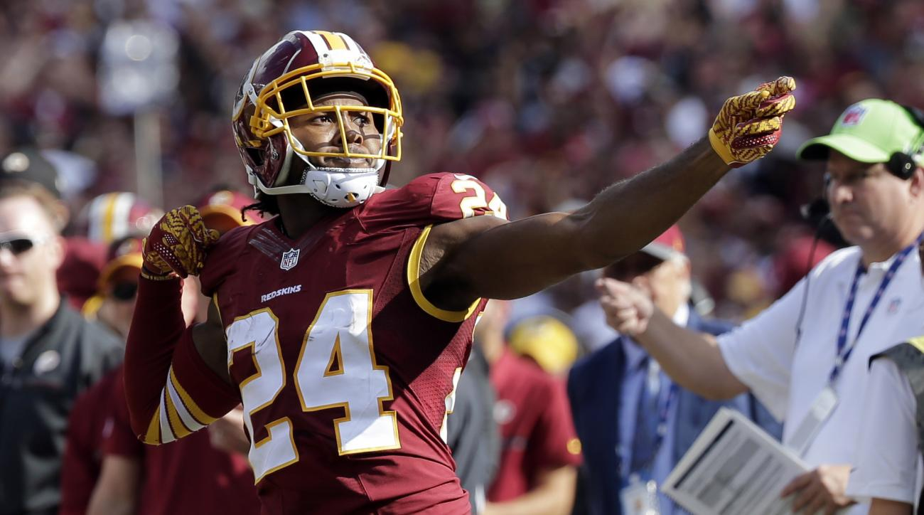 """FILE - In this Oct. 2, 2016, file photo, Washington Redskins cornerback Josh Norman (24) celebrates his interception with a """"bow and arrow,"""" gesture and was penalized for the celebration during the second half of an NFL football game against the Cleveland"""