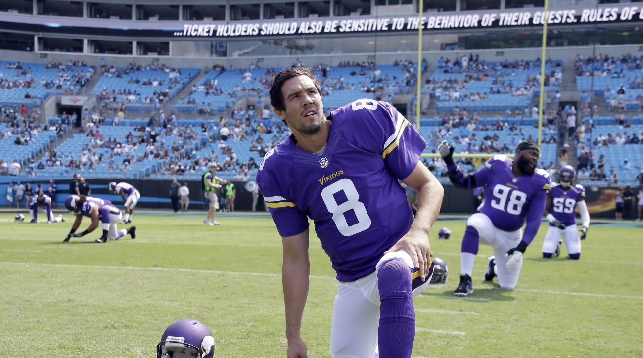 FILE - In this Sept. 18, 2016, file photo, Minnesota Vikings' Sam Bradford (8) stretches before an NFL football game against the Carolina Panthers in Charlotte, N.C. The Vikings could not have expected a better return from the trade they made with Philade