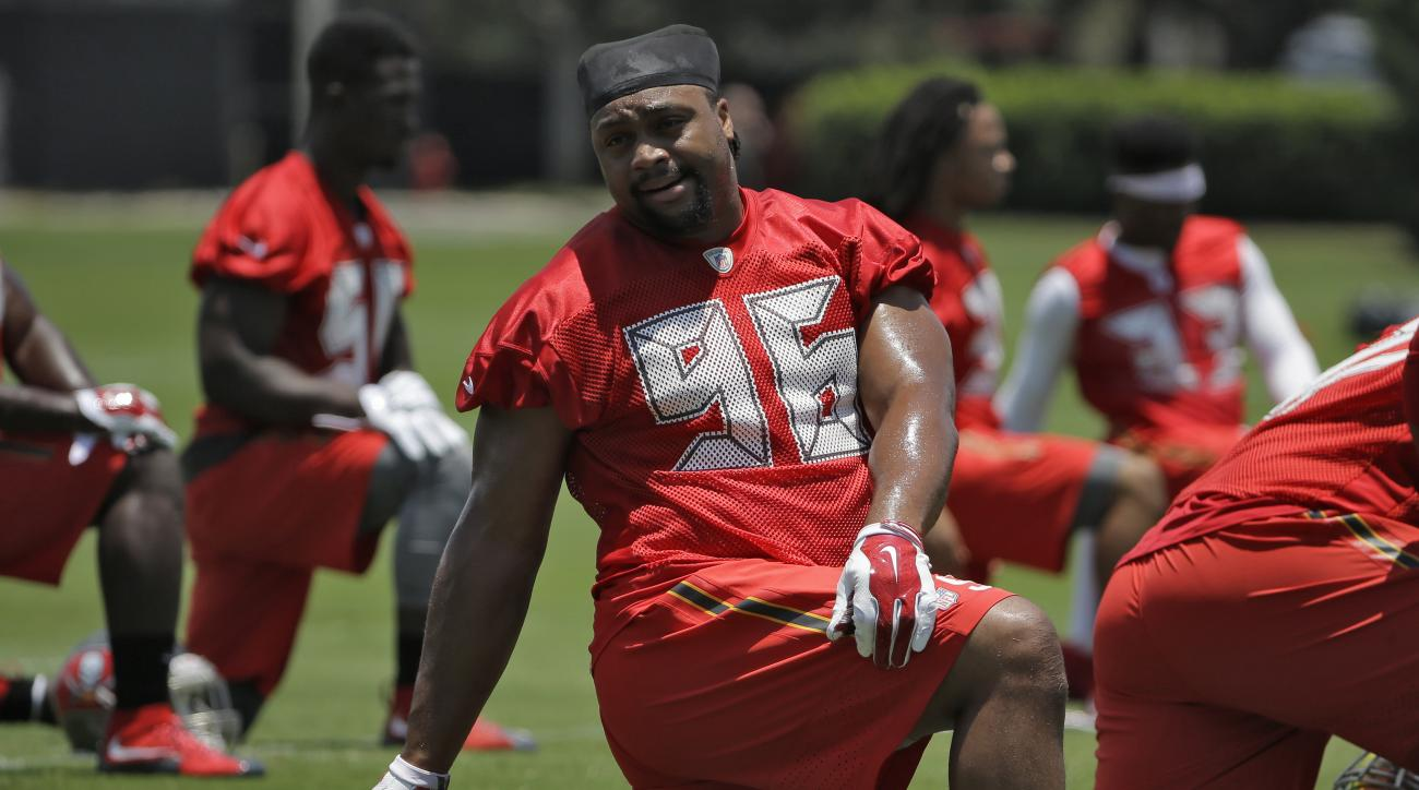 FILE - In this June 15, 2016, file photo, Tampa Bay Buccaneers defensive tackle Cliff Matthews stretches during NFL football minicamp in Tampa, Fla.  The Atlanta Falcons have released safety Dashon Goldson and signed defensive lineman Cliff Matthews on We