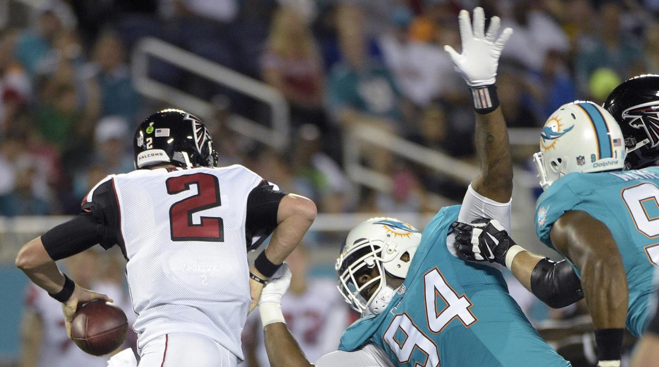 FILE - In this Aug. 25, 2016, file photo, Atlanta Falcons quarterback Matt Ryan (2) is pressured by Miami Dolphins defensive end Mario Williams (94) during the first half of an NFL preseason football game in Orlando, Fla. Nagged by doubts about his effort