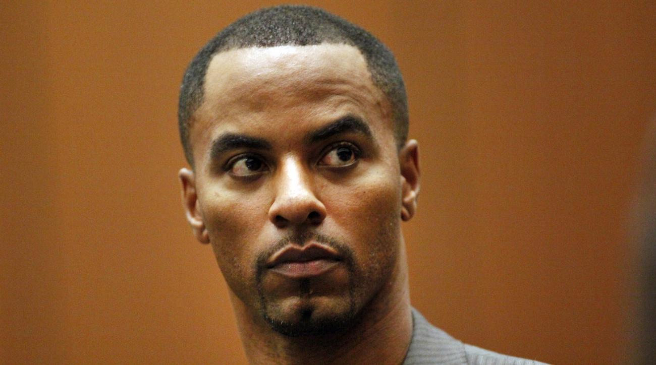 FILE - In this Feb. 20, 2014, file photo, former NFL safety Darren Sharper appears in Los Angeles Superior Court in Los Angeles. The two Louisiana co-defendants in the drug and rape case that brought down one-time NFL star Sharper are set for sentencing i