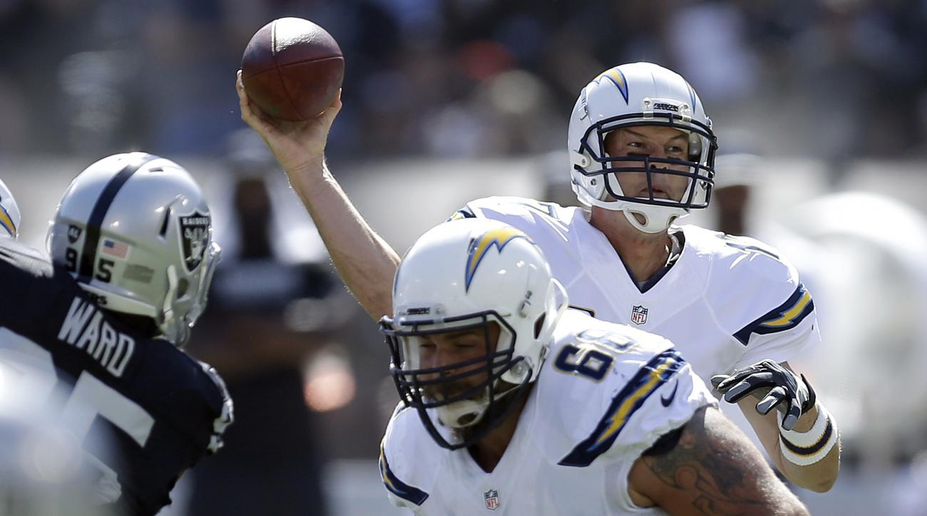 FILE - in this Sunday, Oct. 9, 2016, file photo, San Diego Chargers quarterback Philip Rivers, rear, passes against the Oakland Raiders during the first half of an NFL football game in Oakland, Calif.  San Diego's Rivers and Atlanta's Matt Ryan enter Sund
