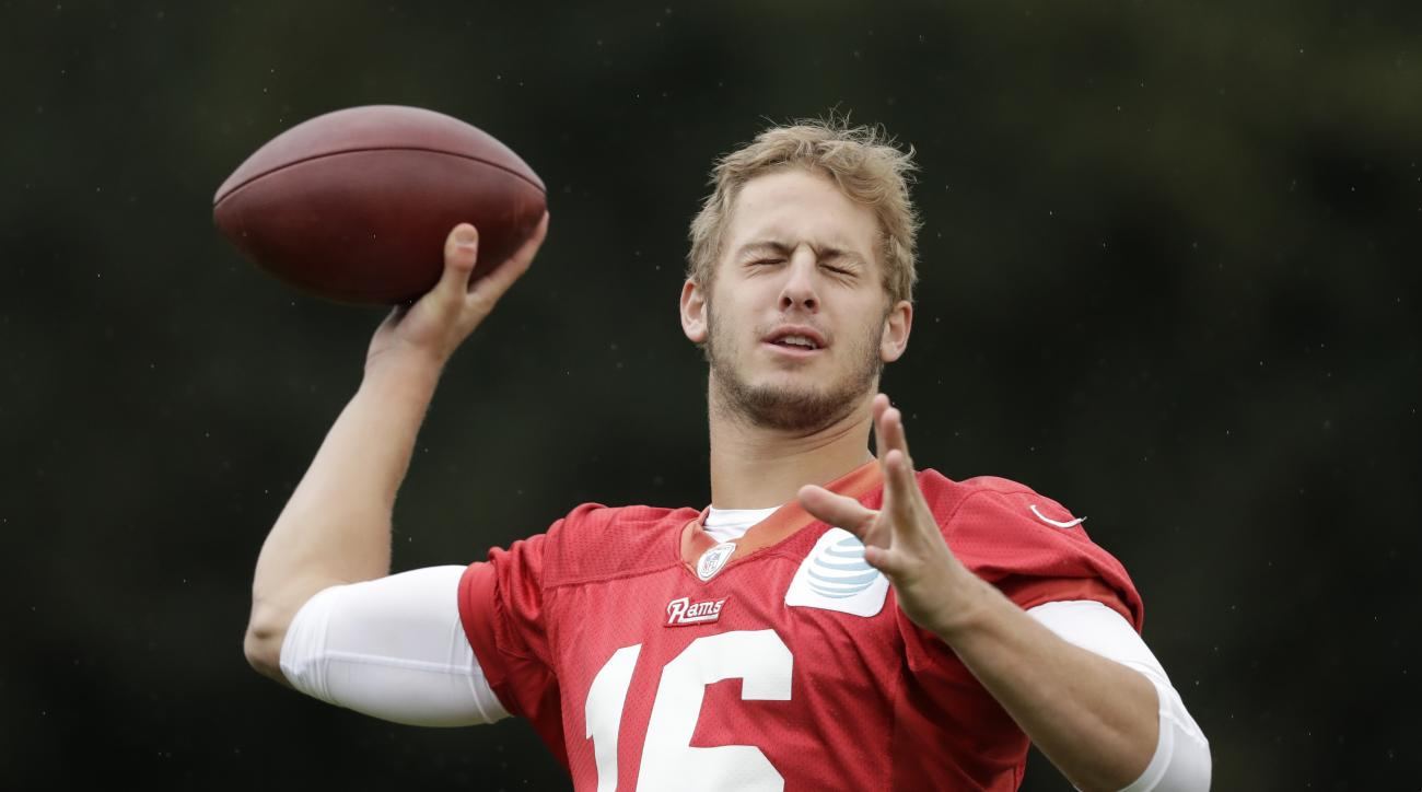 Los Angeles Rams quarterback Jared Goff purposefully throws with his eyes closed as he messes around at the end of a practice session at Pennyhill Park Hotel in Bagshot, England, Thursday, Oct. 20, 2016. The Los Angeles Rams are due to play the New York G