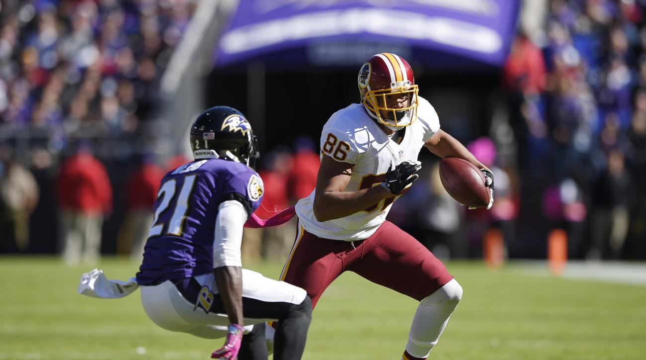 In this photo taken Oct. 9, 2016, Washington Redskins' Jordan Reed (86) runs against Baltimore Ravens' Lardarius Webb (21) during the first half of an NFL football game in Baltimore. Reed and Washington Redskins wide receiver Jackson have missed practice,