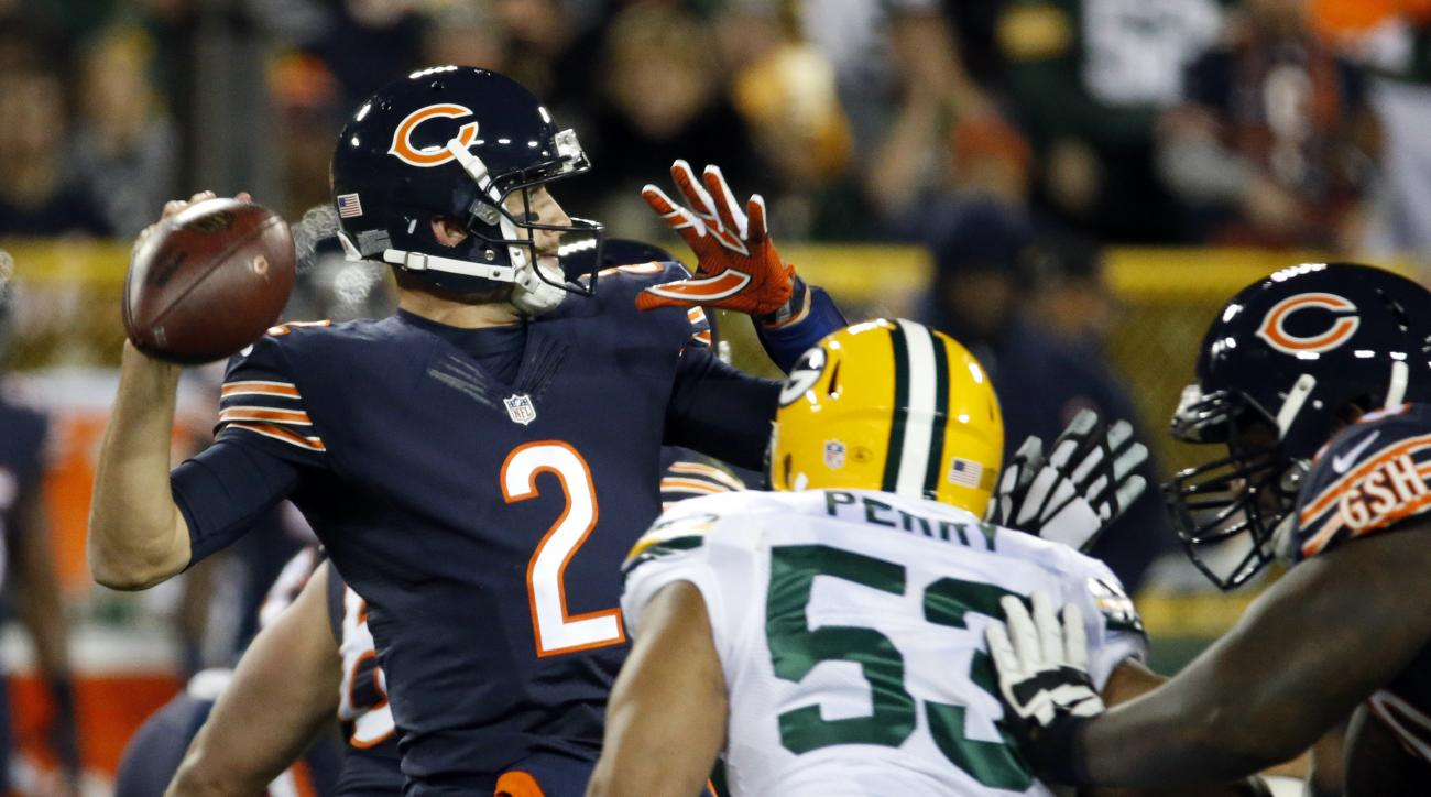 Chicago Bears quarterback Brian Hoyer (2) throws under pressure by Green Bay Packers outside linebacker Nick Perry (53) during the first half of an NFL football game, Thursday, Oct. 20, 2016, in Green Bay, Wis. (AP Photo/Mike Roemer)