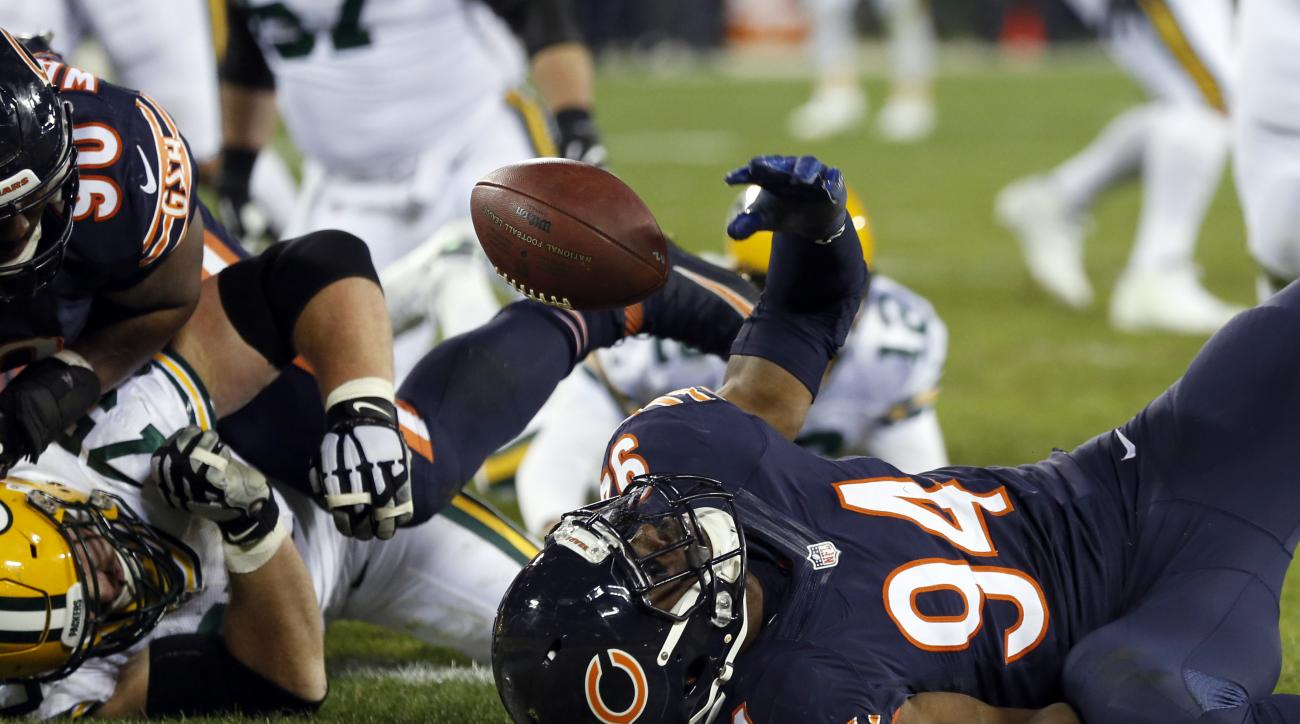 Chicago Bears outside linebacker Leonard Floyd (94) chases a fumble by Green Bay Packers quarterback Aaron Rodgers (12) for a touchdown during the second half of an NFL football game, Thursday, Oct. 20, 2016, in Green Bay, Wis. (AP Photo/Matt Ludtke)
