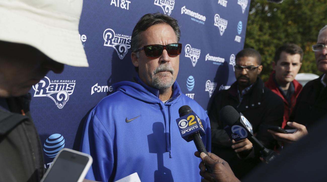 Los Angeles Rams head coach Jeff Fisher speaks to the media after a practice session at Pennyhill Park Hotel in Bagshot, England, Friday Oct. 21, 2016. The Los Angeles Rams are due to play the New York Giants at Twickenham stadium in London on Sunday in a
