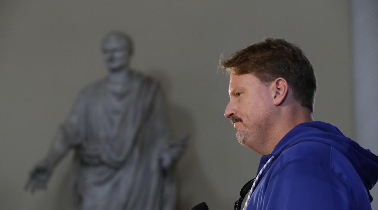 New York Giants head coach Ben McAdoo answers questions from journalists backdropped by a statue of a 1st Century AD Roman Magistrate during a press conference at Syon House in Syon Park, south west London, Friday, Oct. 21, 2016. The Los Angeles Rams are