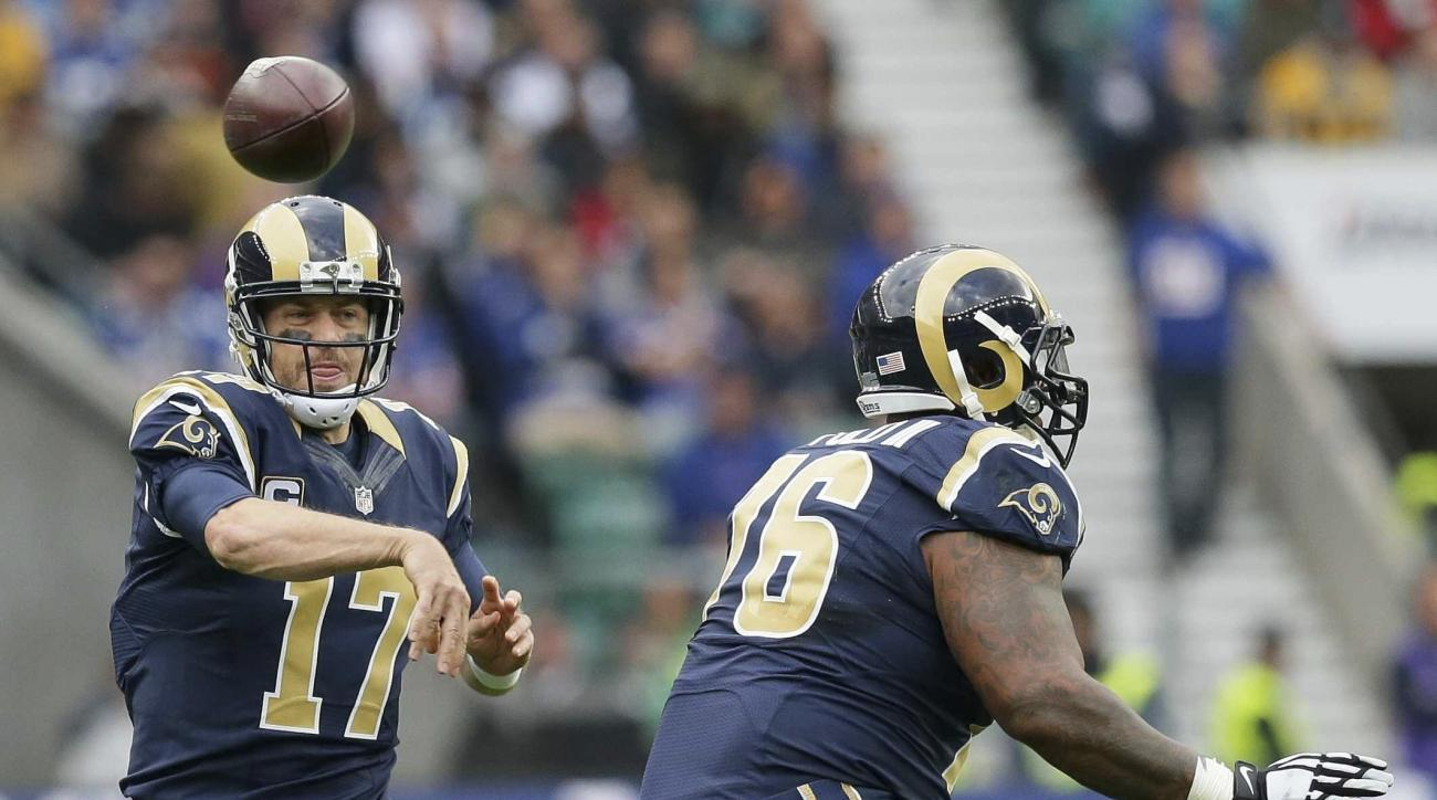 Los Angeles Rams quarterback Case Keenum (17) passes the ball in the first quarter during an NFL football game at Twickenham stadium in London, Sunday Oct. 23, 2016. (AP Photo/Tim Ireland)