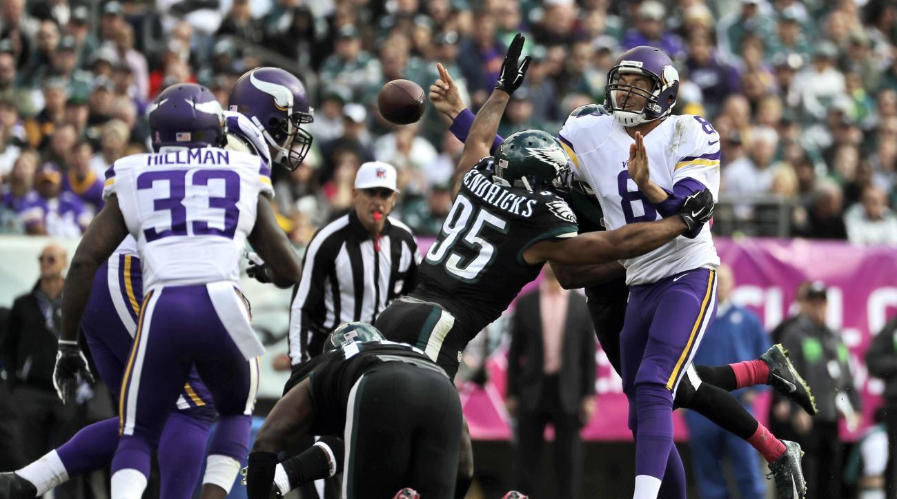 Minnesota Vikings' Sam Bradford, right, fumbles the football as Philadelphia Eagles' Mychal Kendricks tackles during the first half of an NFL football game, Sunday, Oct. 23, 2016, in Philadelphia. (AP Photo/Michael Perez)