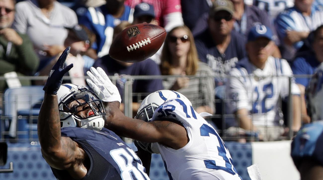 Tennessee Titans tight end Delanie Walker (82) reaches for a pass as he is defended by Indianapolis Colts free safety T.J. Green (32) in the first half of an NFL football game Sunday, Oct. 23, 2016, in Nashville, Tenn. Green was called for pass interferen